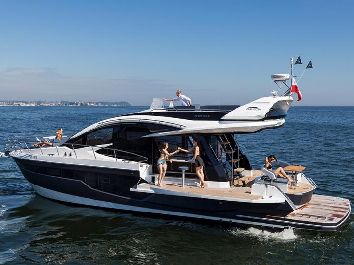 Discover boating aboard the 53ft Galeon 510 SKY powerboat for rent in Cala D'or, Spain - a 3 cabins yacht charter.