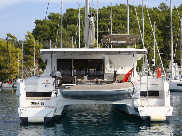 Private catamaran boat for rent in Göcek, Turkey.