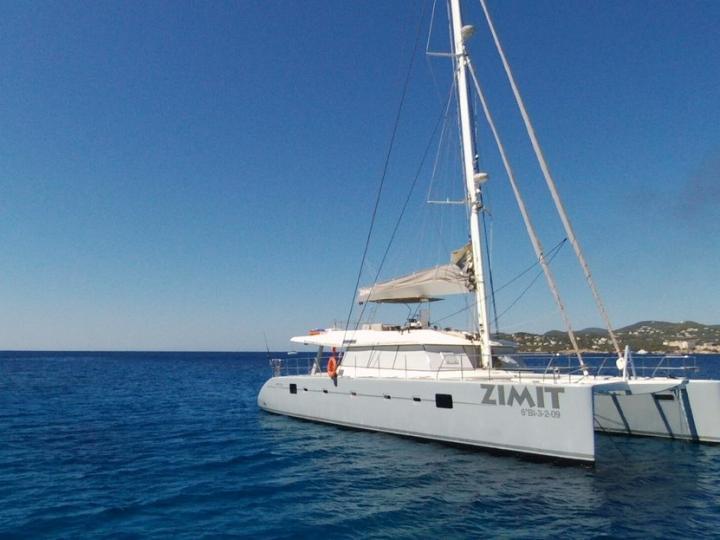 Explore the amazing Sant Antoni de Portmany, Ibiza, Spain on a catamaran - rent the 60ft Zimit boat and discover sailing.
