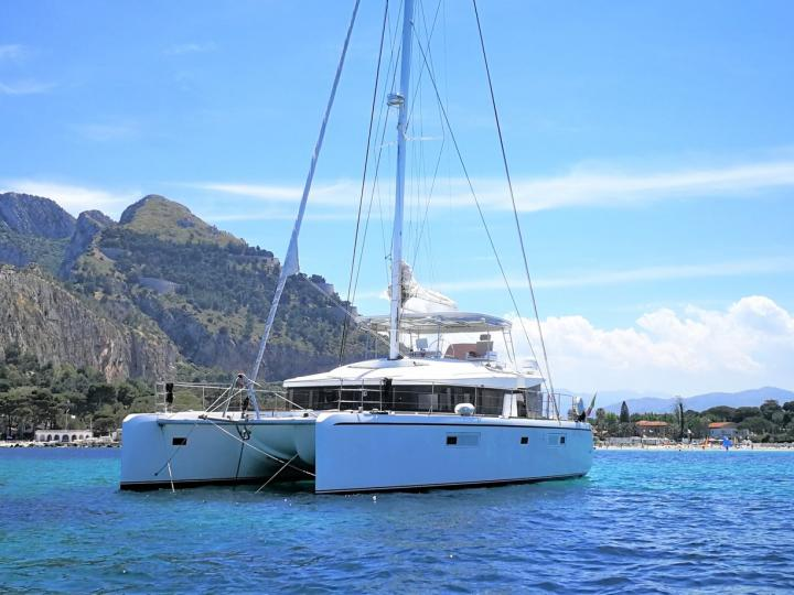 Discover boating aboard the 52ft Denilos boat in Cannigione, Italy - a 6 cabins catamaran for rent.