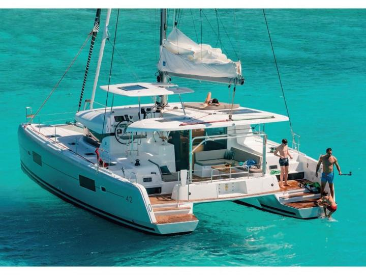 Catamaran boat for rent in Portisco, Italy, for up to 8 guests.