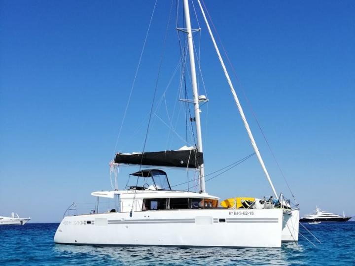 Explore the amazing Sant Antoni de Portmany, Ibiza, Spain on a catamaran - rent the 46ft Cidici boat and discover sailing.