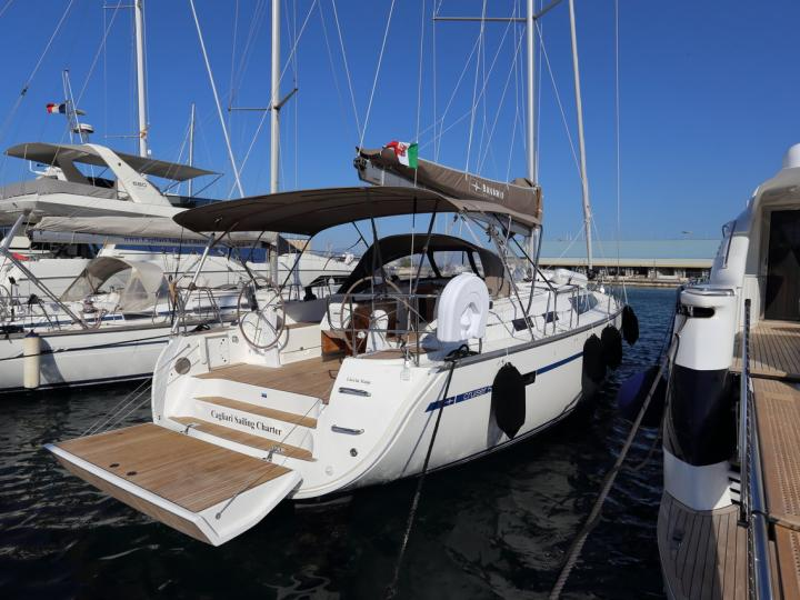Cruise the beautiful waters of Marinella, Italy aboard this great boat for rent.