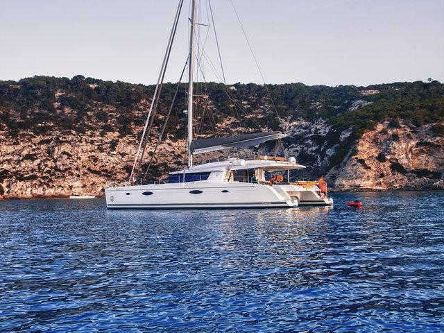 Rent a catamaran in Sant Antoni de Portmany, Ibiza, Spain - the Magec boat.